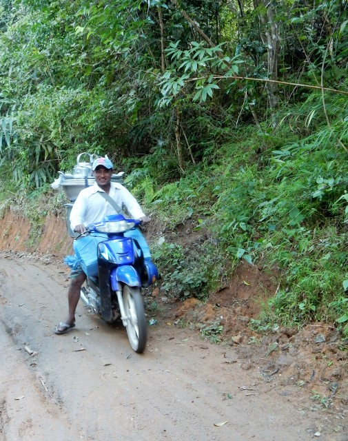 A few motorcycles passed us during our trek--although on a rainy day, we'd stick to walking.