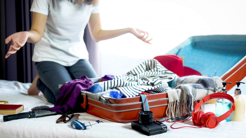 suitcase packing tips colorful suitcase