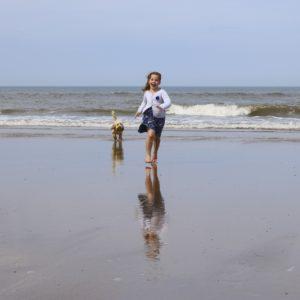 girl on beach in dog-friendly charleston