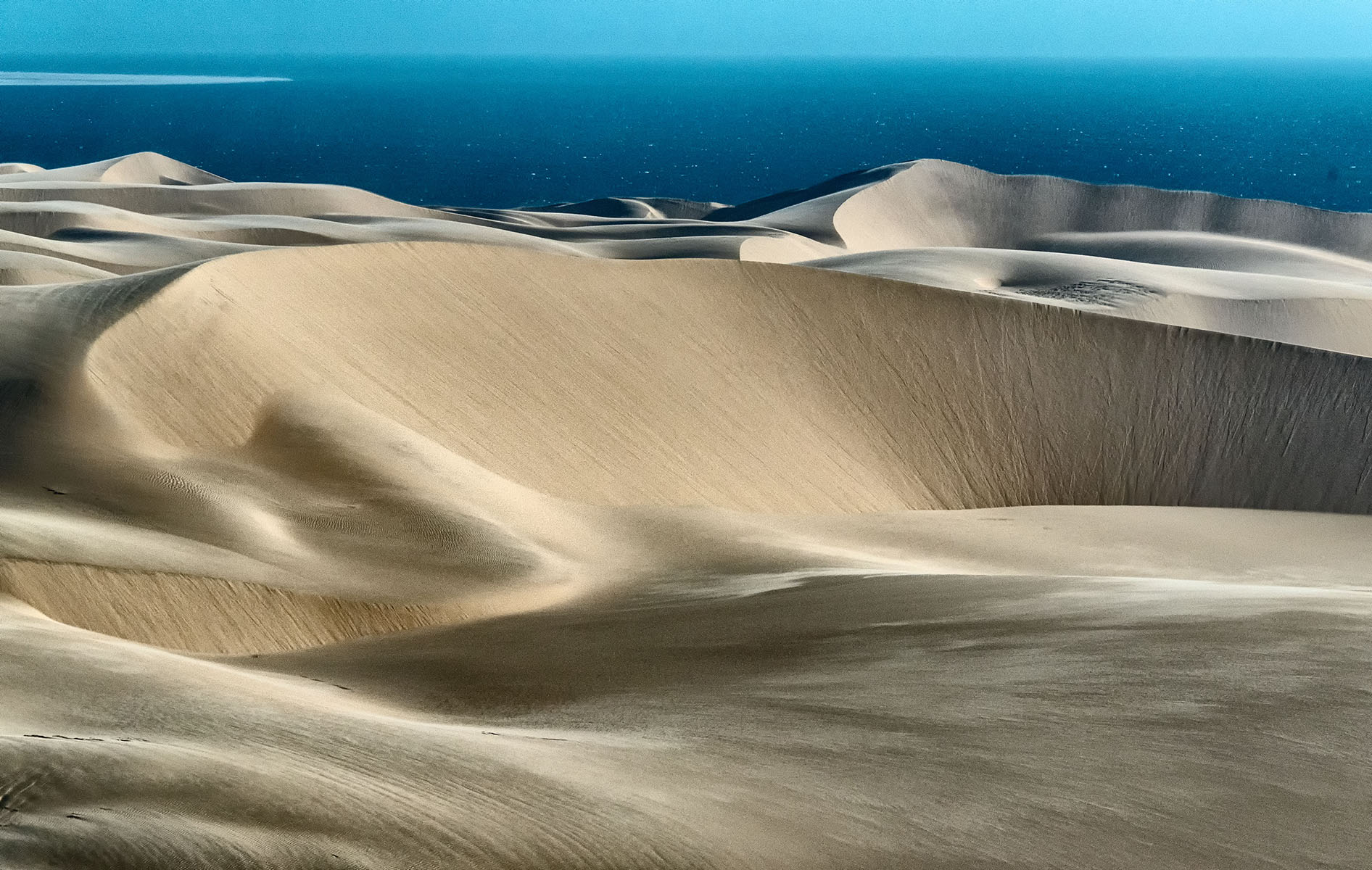 sand dunes and Atlantic Ocean in stunning Namibia