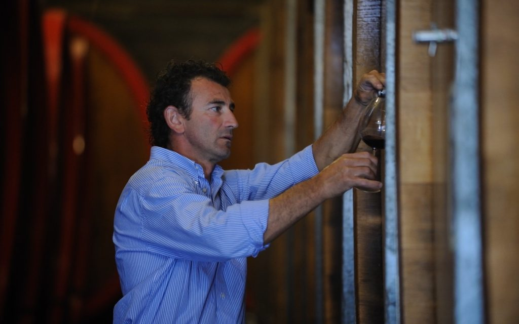 Winemaker Massimo Colluato testing wine (Photo courtesy Travaglini Estate Wines)